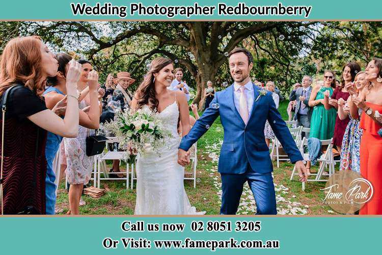 Photo of the Bride and the Groom showering bubbles by the visitors Redbournberry NSW 2330