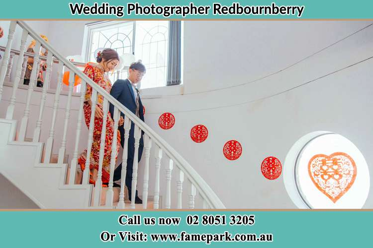 Photo of the Bride and the Groom going down the stair Redbournberry NSW 2330