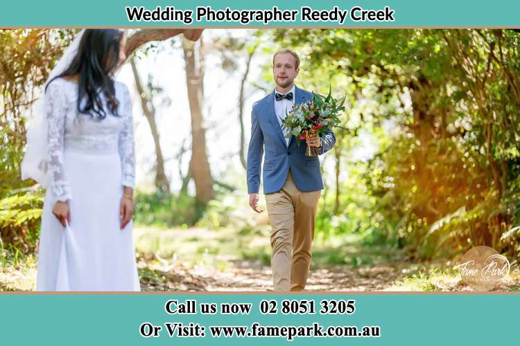 Photo of the Groom bringing flower to the Bride Reedy Creek NSW 2330