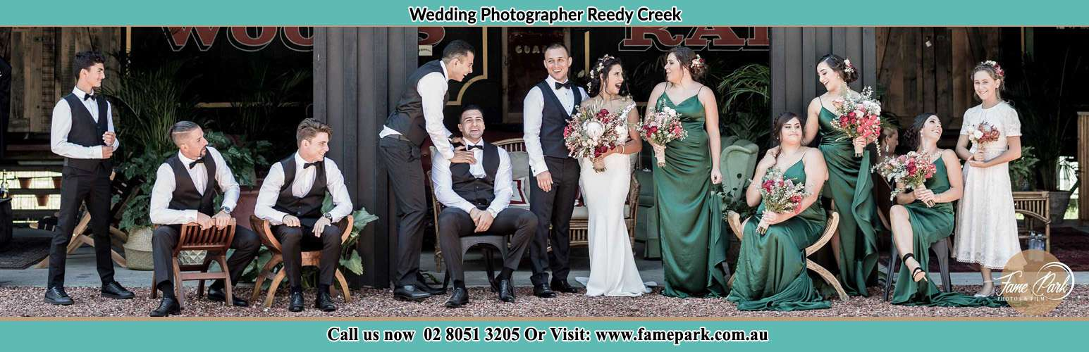 The Bride and the Groom with their entourage pose for the camera Reedy Creek NSW 2330