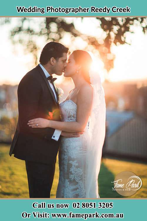 Photo of the Groom and the Bride kissing at the yard Reedy Creek NSW 2330