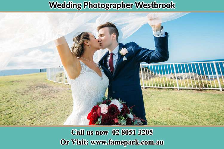 Photo of the Bride and the Groom kissing at the yard Westbrook NSW 2330