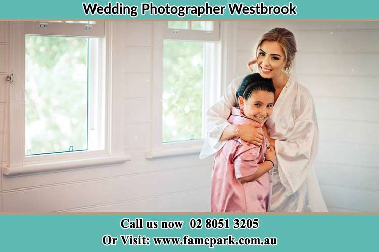 Photo of the Bride hugging the flower girl Westbrook NSW 2330