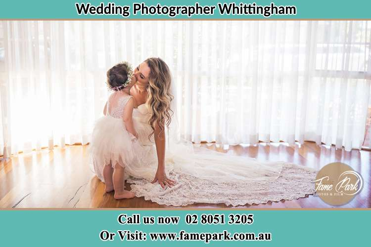Photo of the Bride kiss the flower girl Whittingham NSW 2330