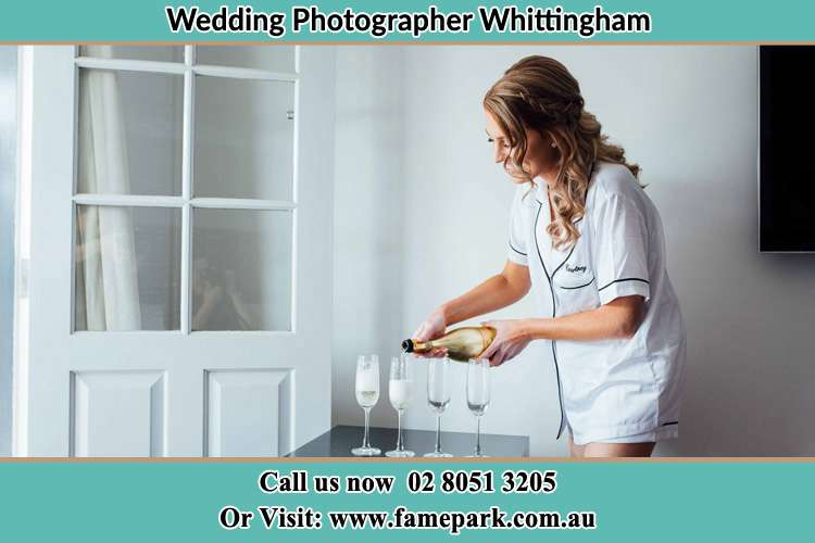 Photo of the Bride pouring wine on the glasses Whittingham NSW 2330
