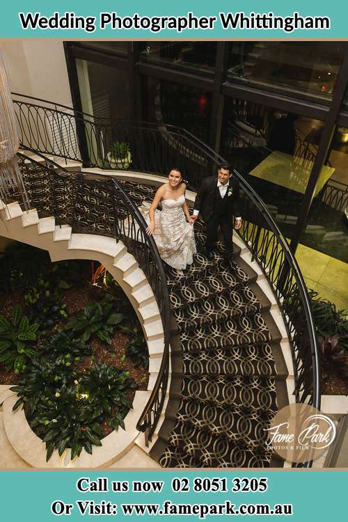 Photo of the Bride and the Groom going down the stair Whittingham NSW 2330