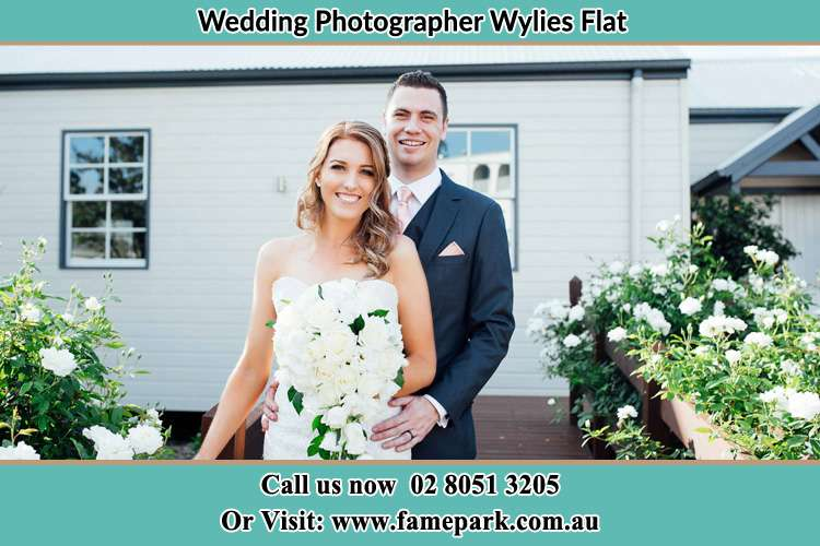 Photo of the Bride and the Groom at the front house Wylies Flat NSW 2330